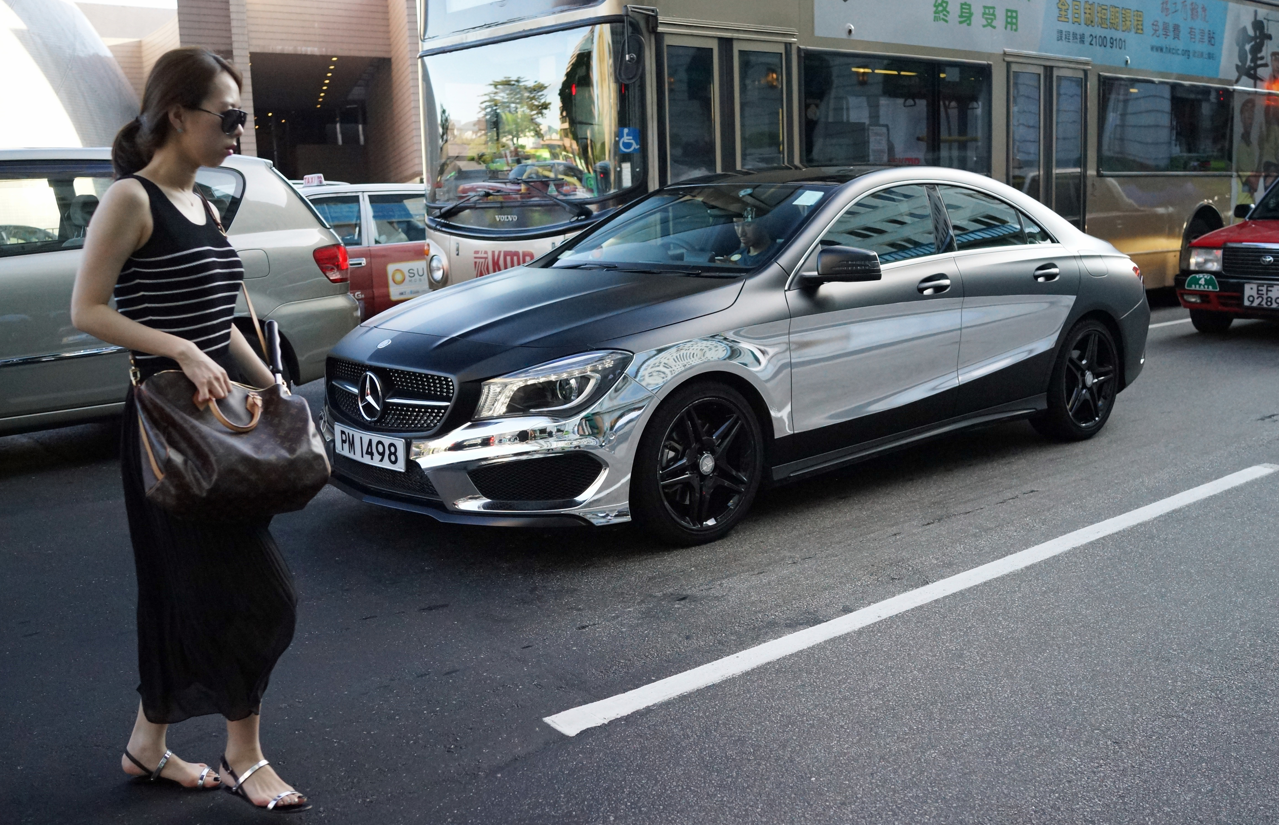 My focus was on the awesome half metallic Mercedes Benz in the background, it was only later I noticed the lady and her LV bag - a perfect fit for the guy driving the Benz! -