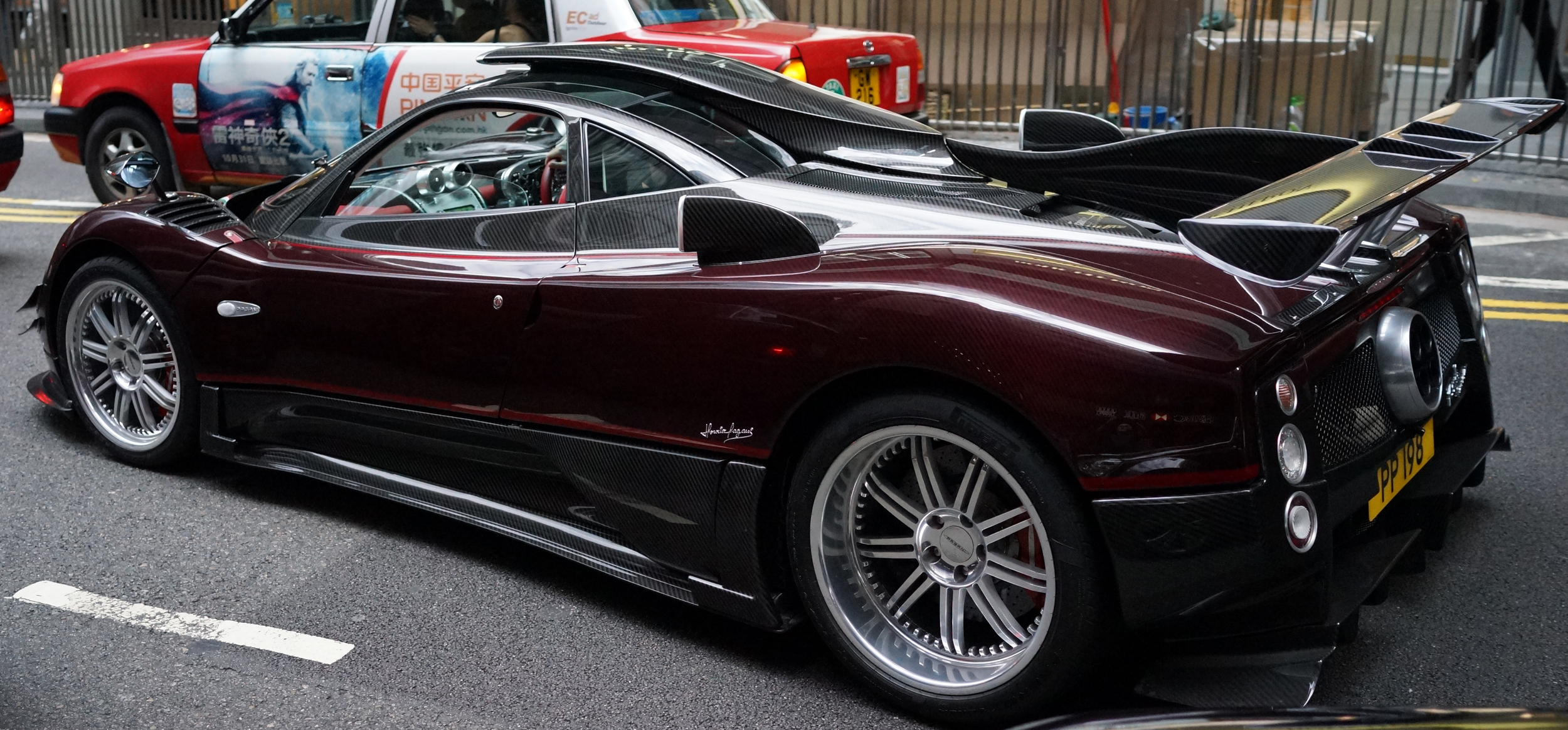 Pagani - PP 198  / A very in your face car with a very subtle number plate, essentially 198 translates to certain long life and wealth. I still remember the day I took this image, I ran into moving traffic to get the shot as for me this is simply the most amazing car in Hong Kong.