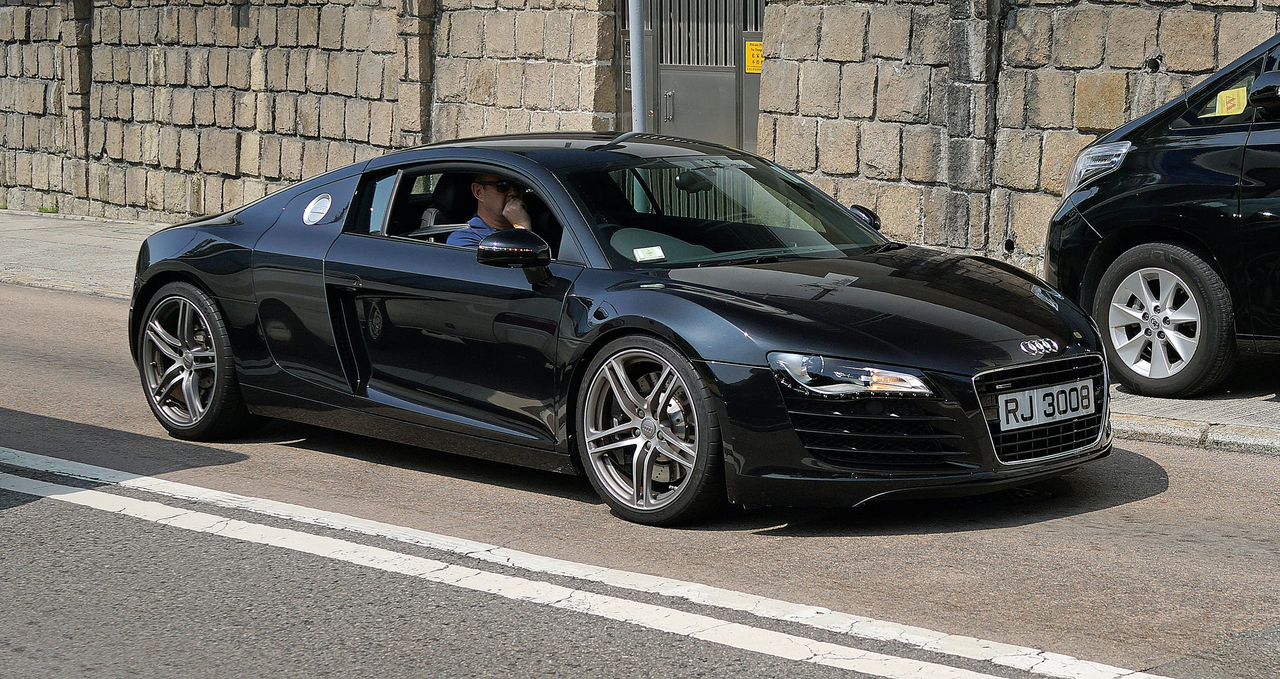 ... and when he can't be bothered with the Harley he takes out his Audi R8 for a spin !!