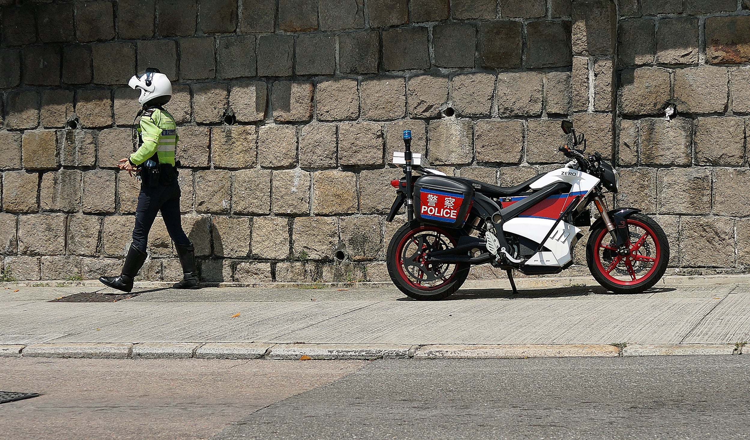 A traffic cop on his whizzo electric bike makes a stop opposite the Hong Kong Country Club to give out some tickets to patrons who illegally park...