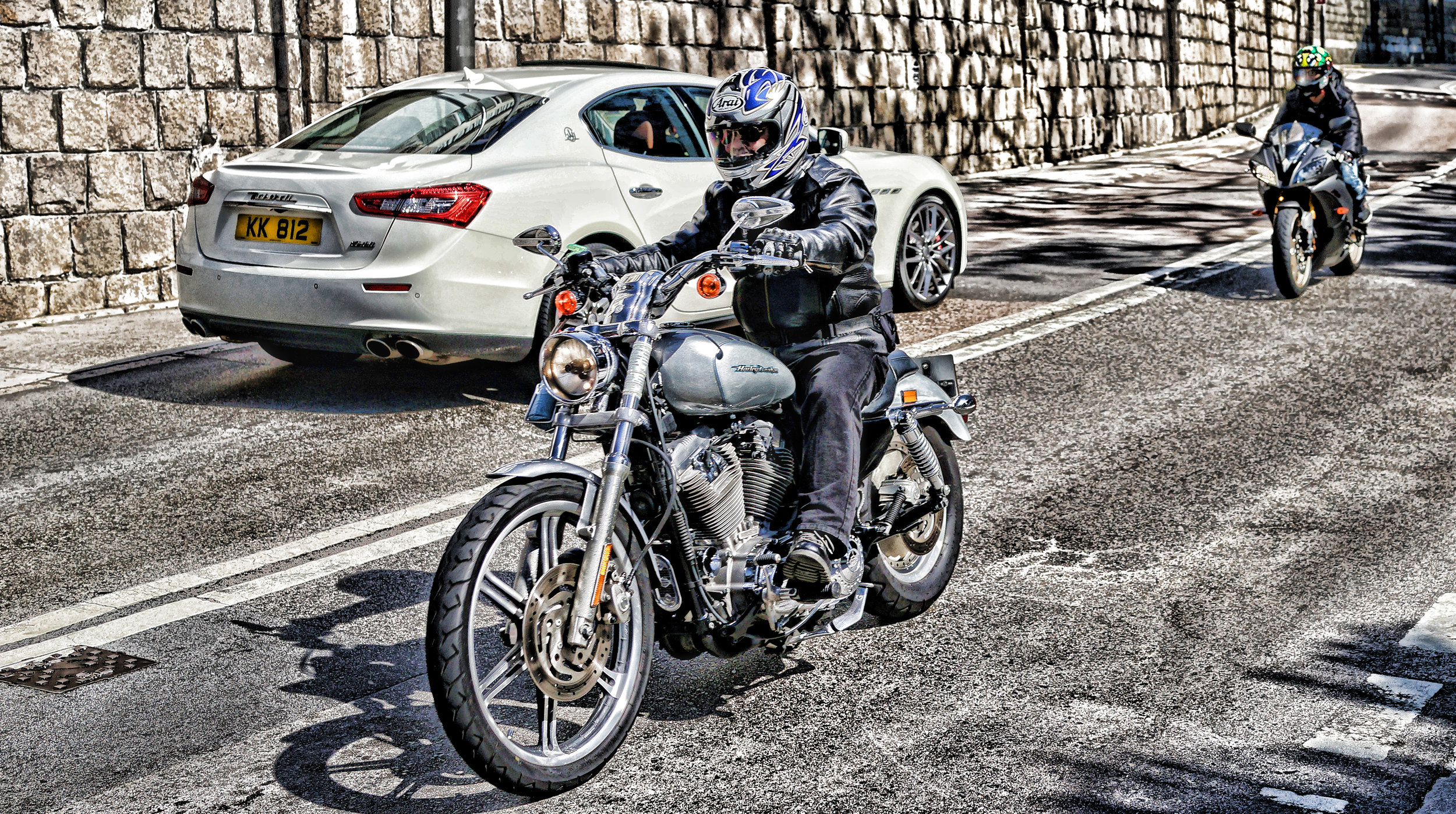 Quite a rare image, a fancy bike and a fancy car in the same image, I think a Maserati has a lot of class and that engine sound! and a Harley speaks for itself... that rumble you can hear a mile away!! ... awesome!