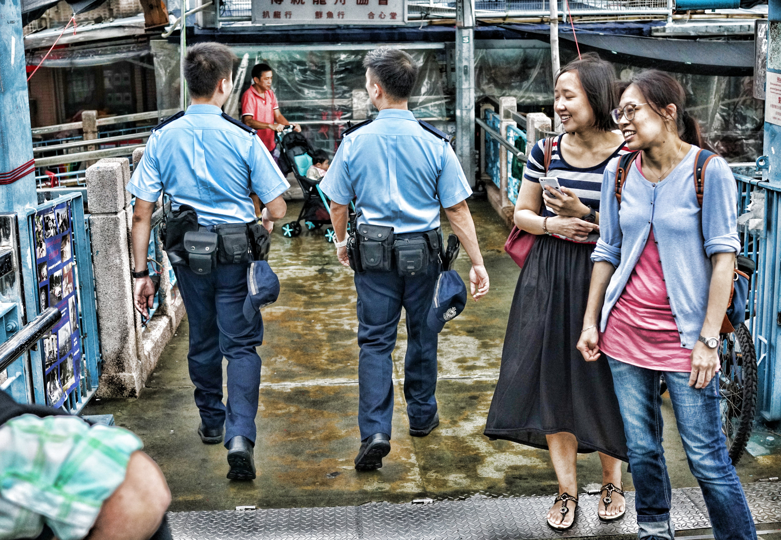 A couple of our gun toting cops patrolling the streets of the Tai O Fishing Village