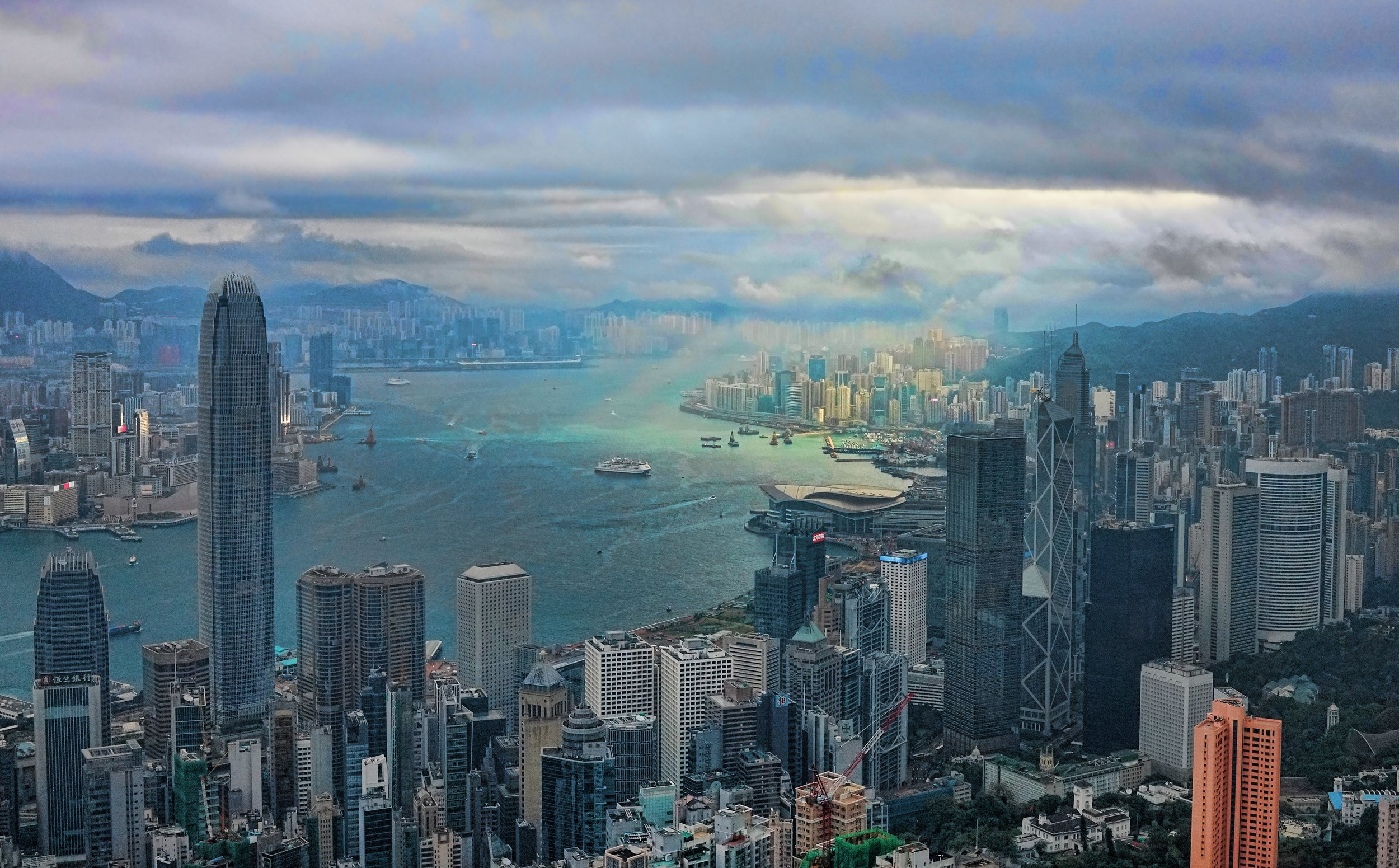 Hong Kong Airport Layover / Transit Tours -  One of those lucky images I get once in a while, I call it the god moment where the clouds part and the sun shines through.... naturally the image was taken at my spot at the Peak!
