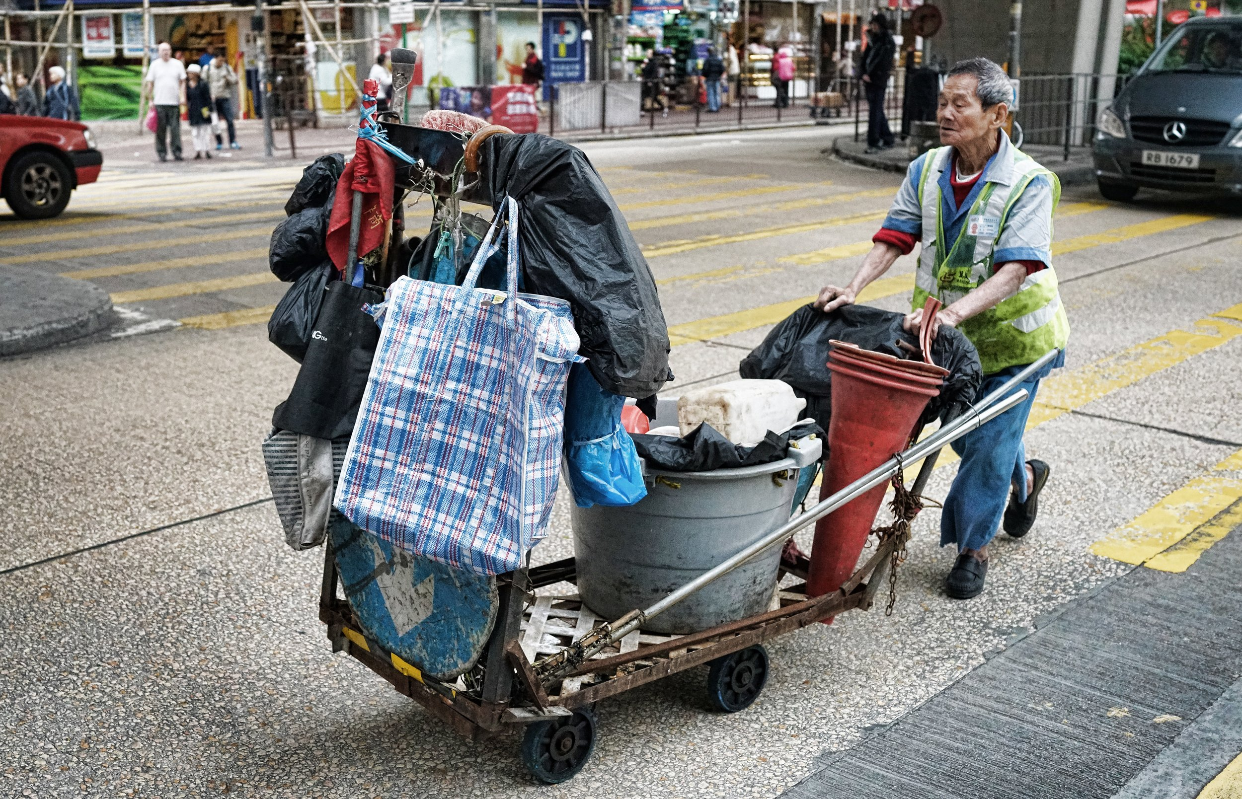 This old geezer to me is a bit of a tragic figure as he cleans the streets around Tai Kok Tsui in Kowloon.... it is about time he was at home with his feet up, watching the tele and drinking a cup of hot coco... the reality is a little grimmer as you can see