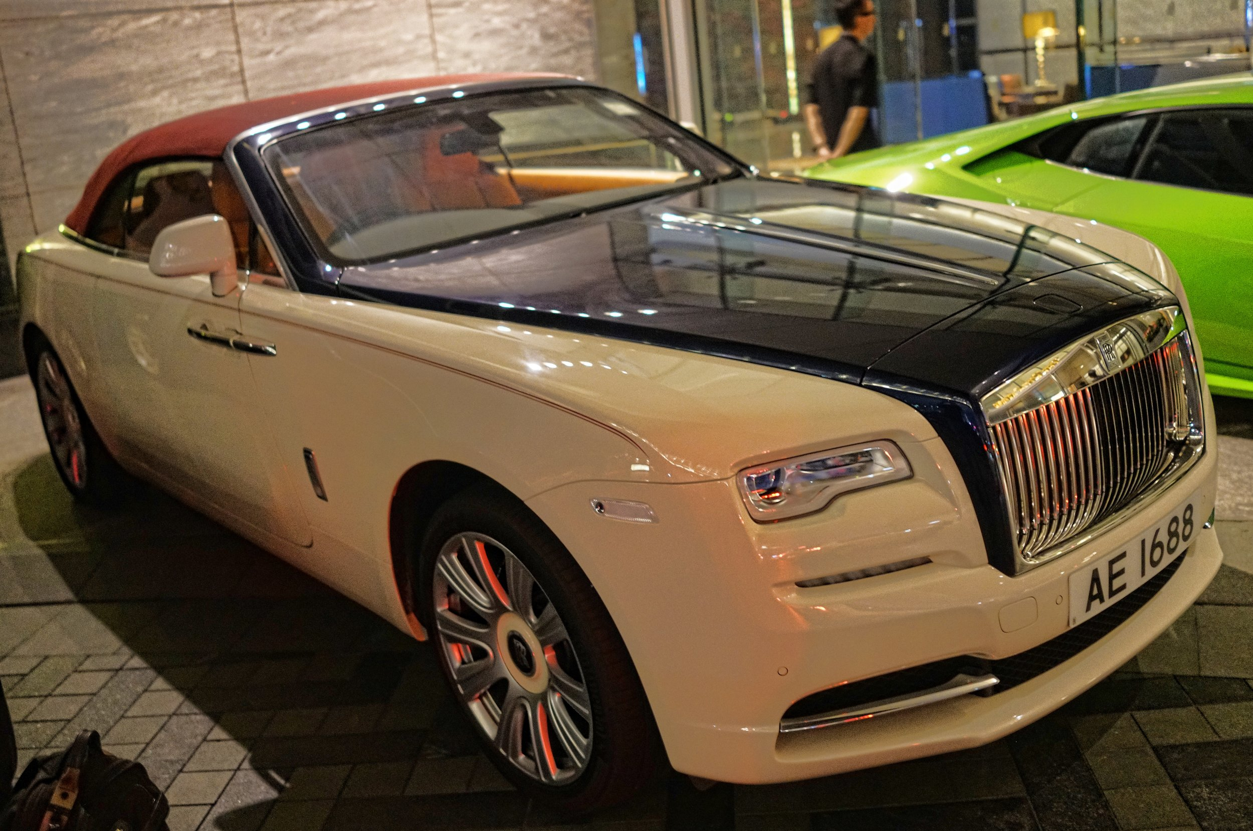 Oh Lordy, the new Rolls Royce Dawn and what a simply stunning car, love the number plate as well, it is a very lucky number is 1688... I like visiting the Ritz Carlton Hotel.. always lots of lovely cars parked there and the view from the lobby on the 103rd floor is stunning.