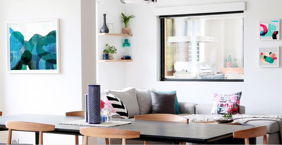 'Wetlands' (left) and customised prints of 'In the Pacific' and  'Peninsular' (far right) and  tram cushion featured in Bec and Georges living area.