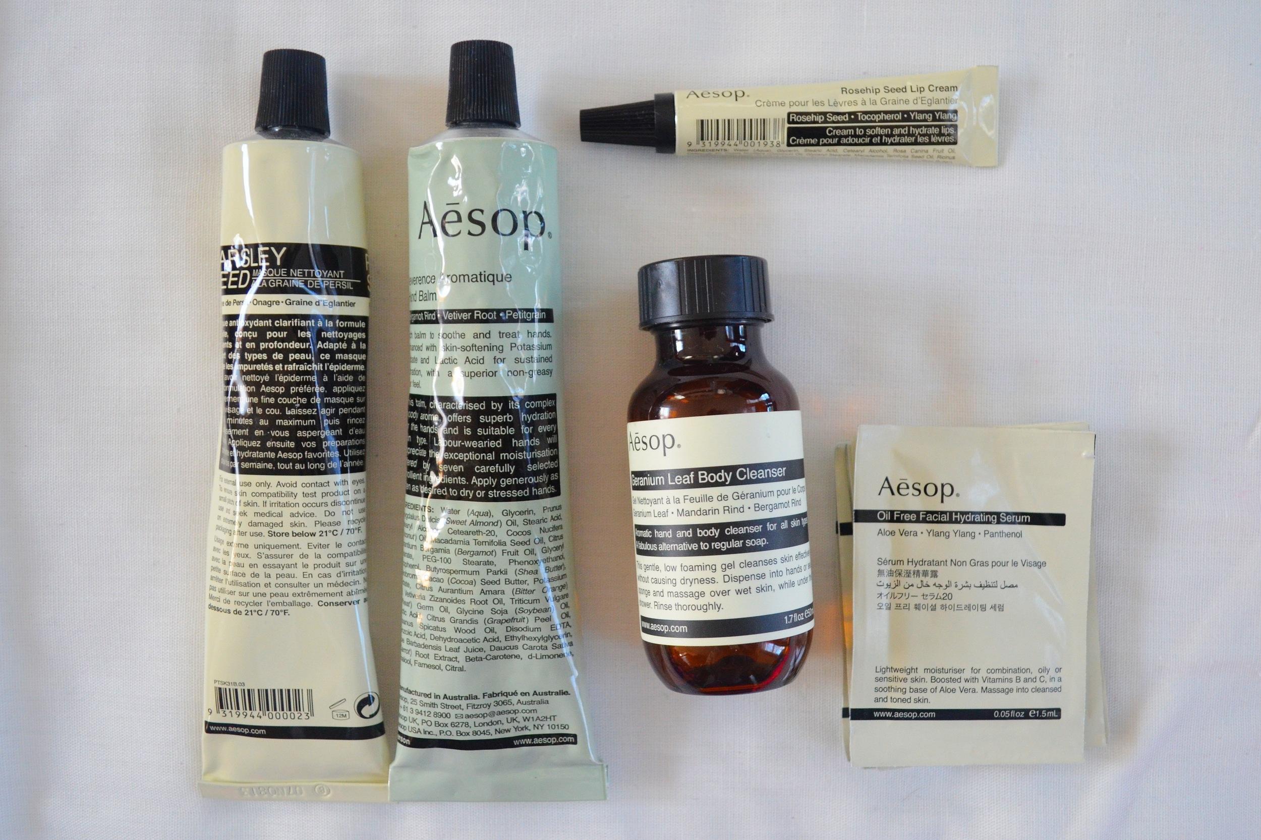 L-R: Aesop Parsley Seed Cleansing Masque, Aesop Reverence Aromatique Hand Balm, Aesop Rosehip Seed Lip Cream, Aesop Geranium Leaf Body Cleanser Sample, Aesop Skincare Samples