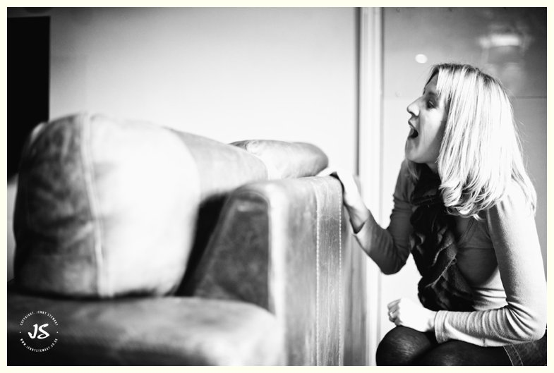 adult female hiding behind sofa