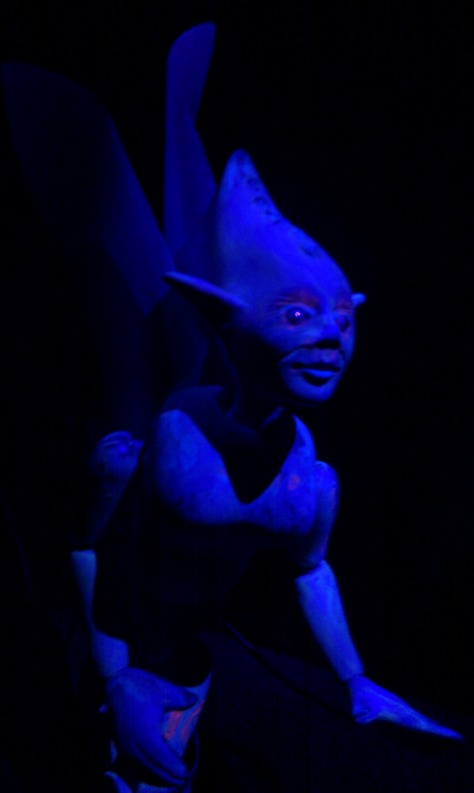 Black light micro puppetry inside the tent.