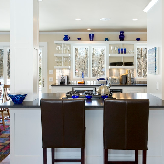 This modern Kitchen design features open spaces, linear lines and a spacious feel with the open shelving.
