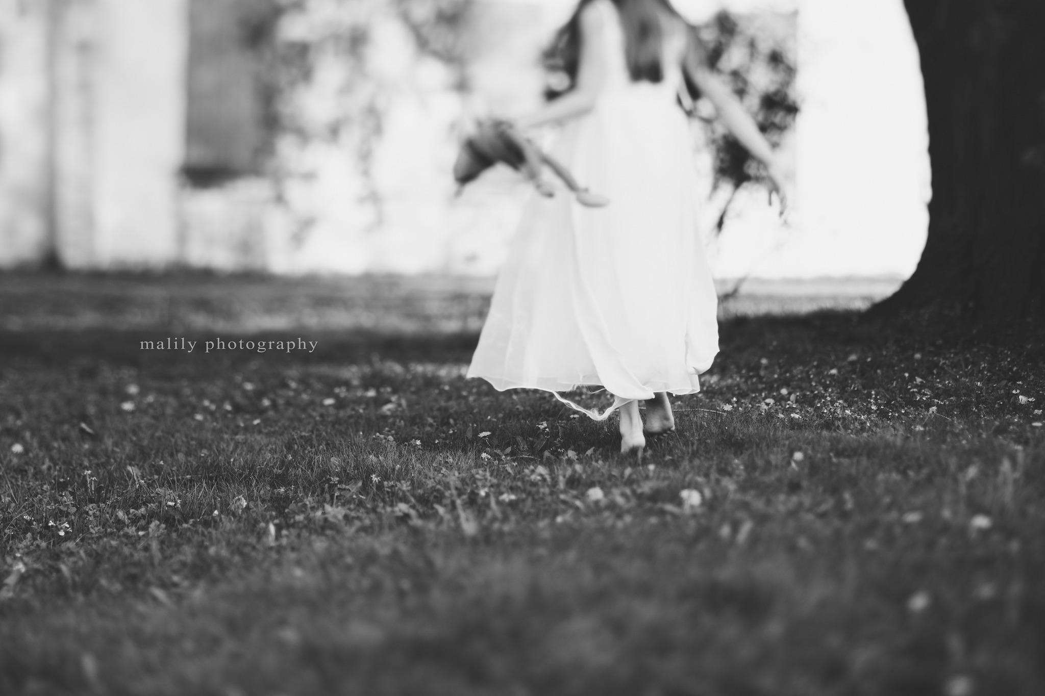 malily photography | little girl running with doll