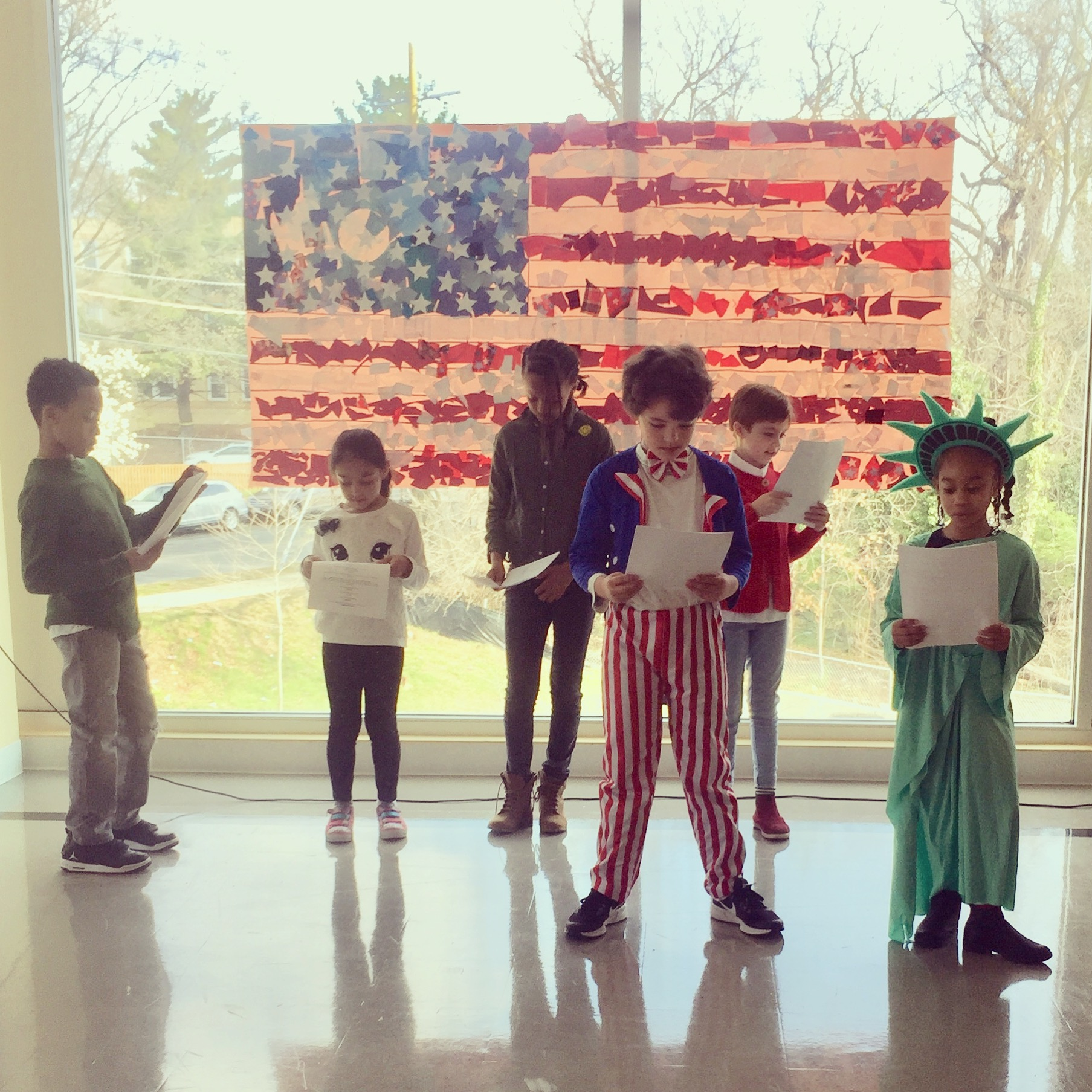 Bridges' Annual America Celebration spring 2018. Uncle Samantha, Lady Liberty and four citizen who represent the diversity of our inclusive country.