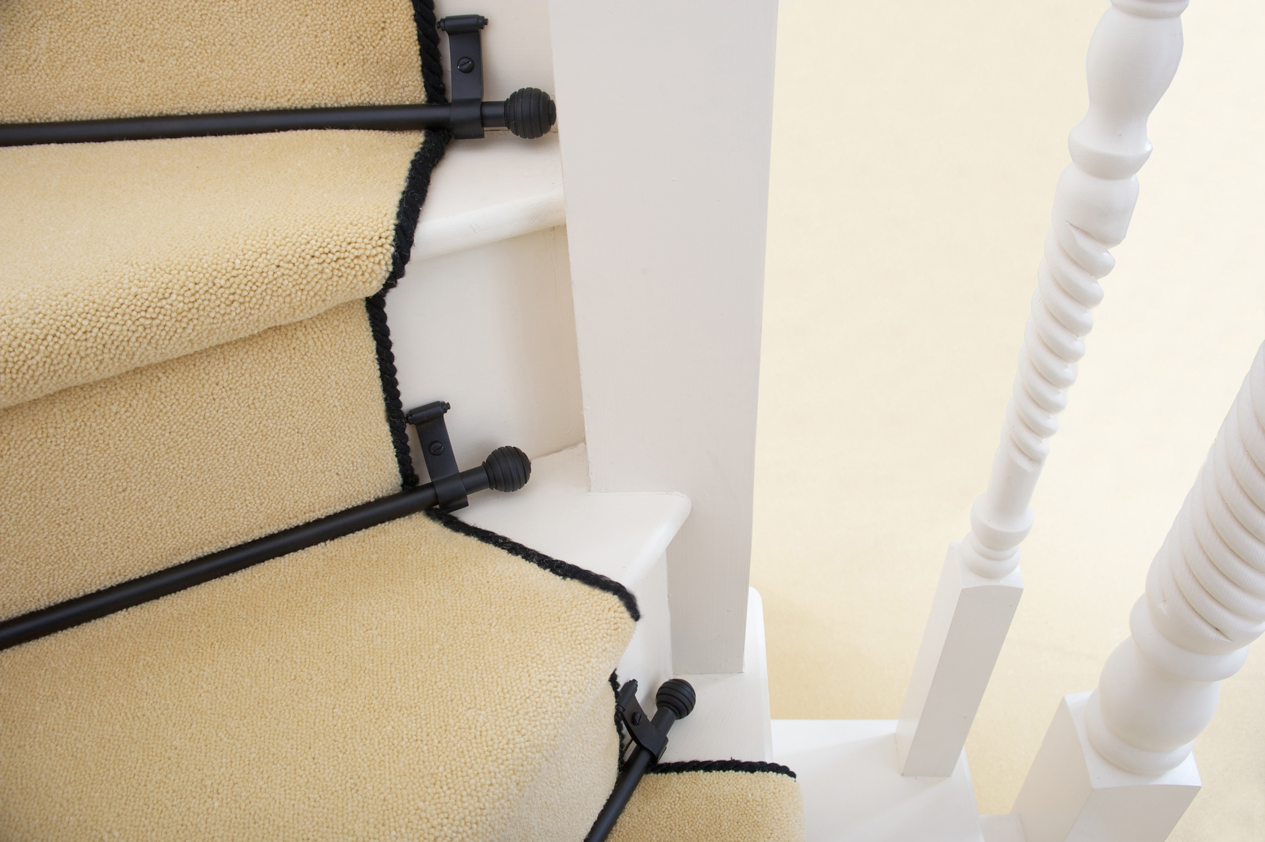 Universal Bracket used to fit stair rods on winding staircases.