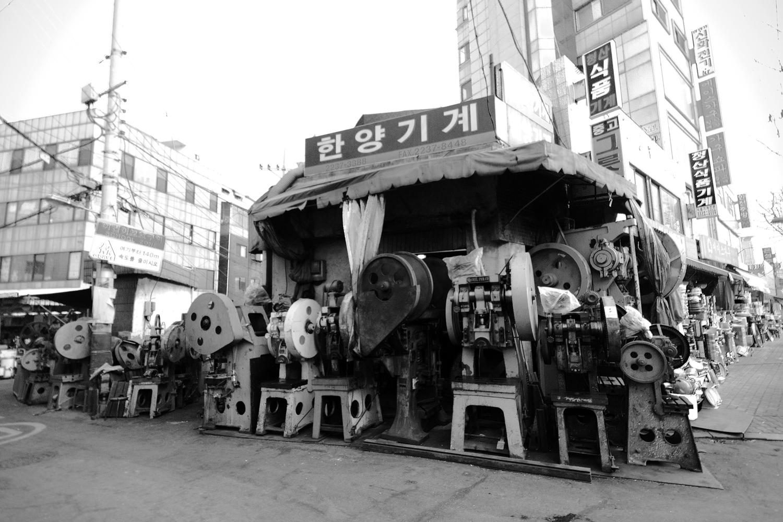Out of Date Machines Overrun Sidewalk  Seoul  2012