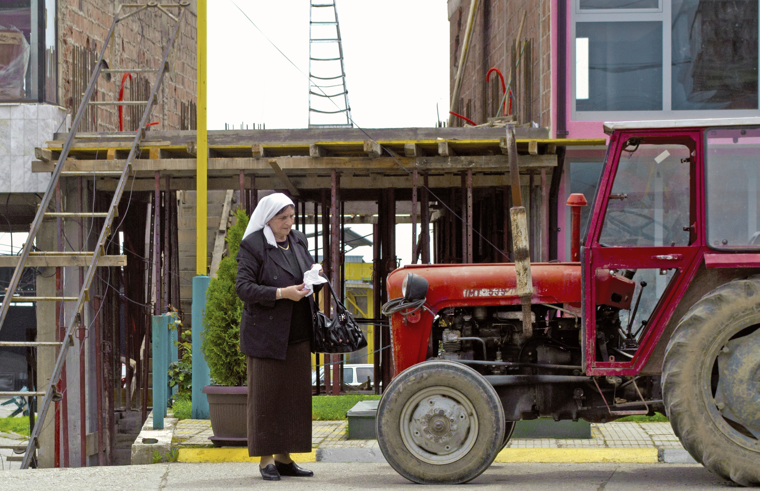 HM13Kosovo-Woman-Tractor-cropped-colorcorrected.jpg