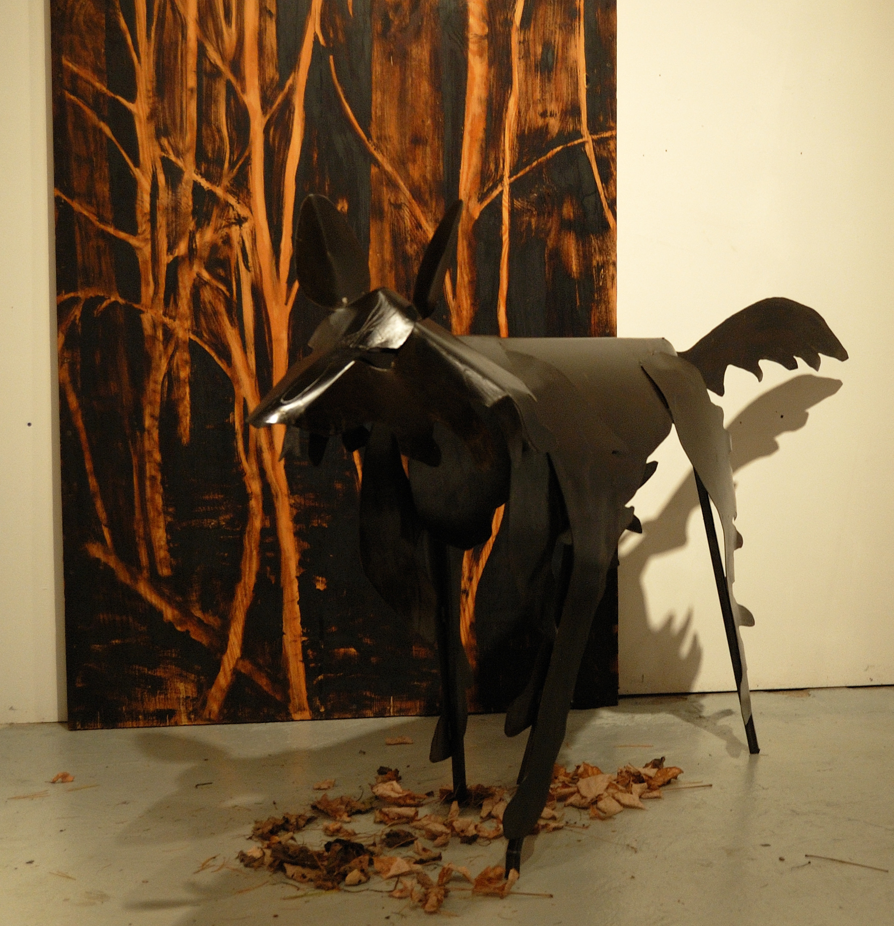"""Living Room"" was a one-person show at Gallery 13, 811 LaSalle St., Minneapolis, MN.  The animals are life-size, Corten steel, the panels, both freestanding  and wall-hung, are each 4' x 8' plywood, painted in asphaltum. This is Grimm's Wolf in steel."