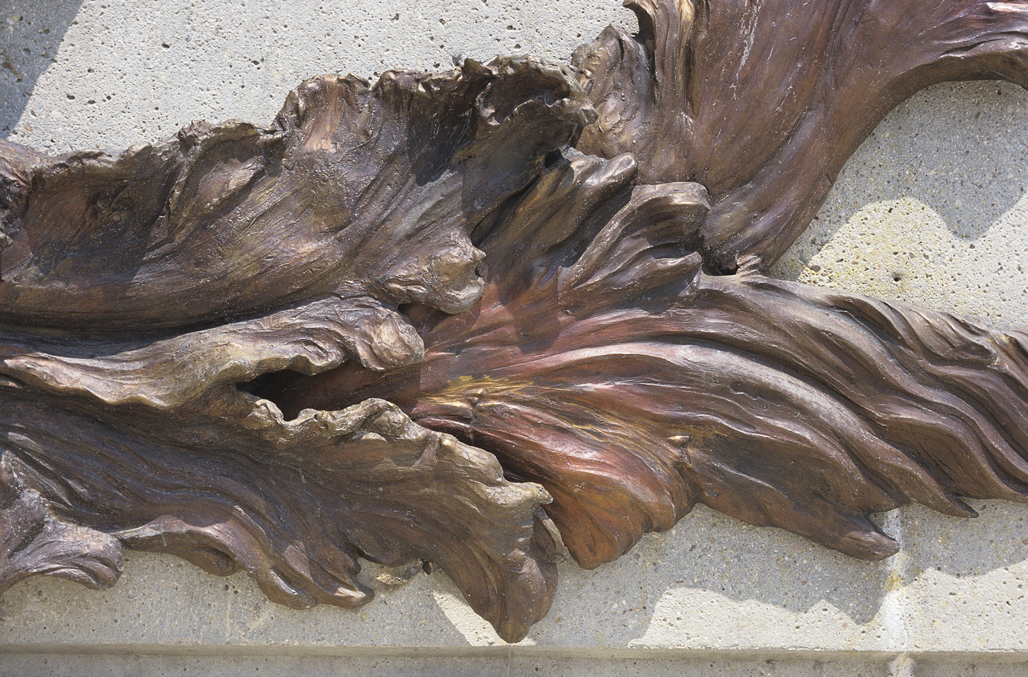 Floodwaters , bronze detail. The bronze has a complex hot patina using ferric oxide, liver of sulphur, and other acids, finished with a hot wax and buffed. This  gives it its variegated, shifting colors.