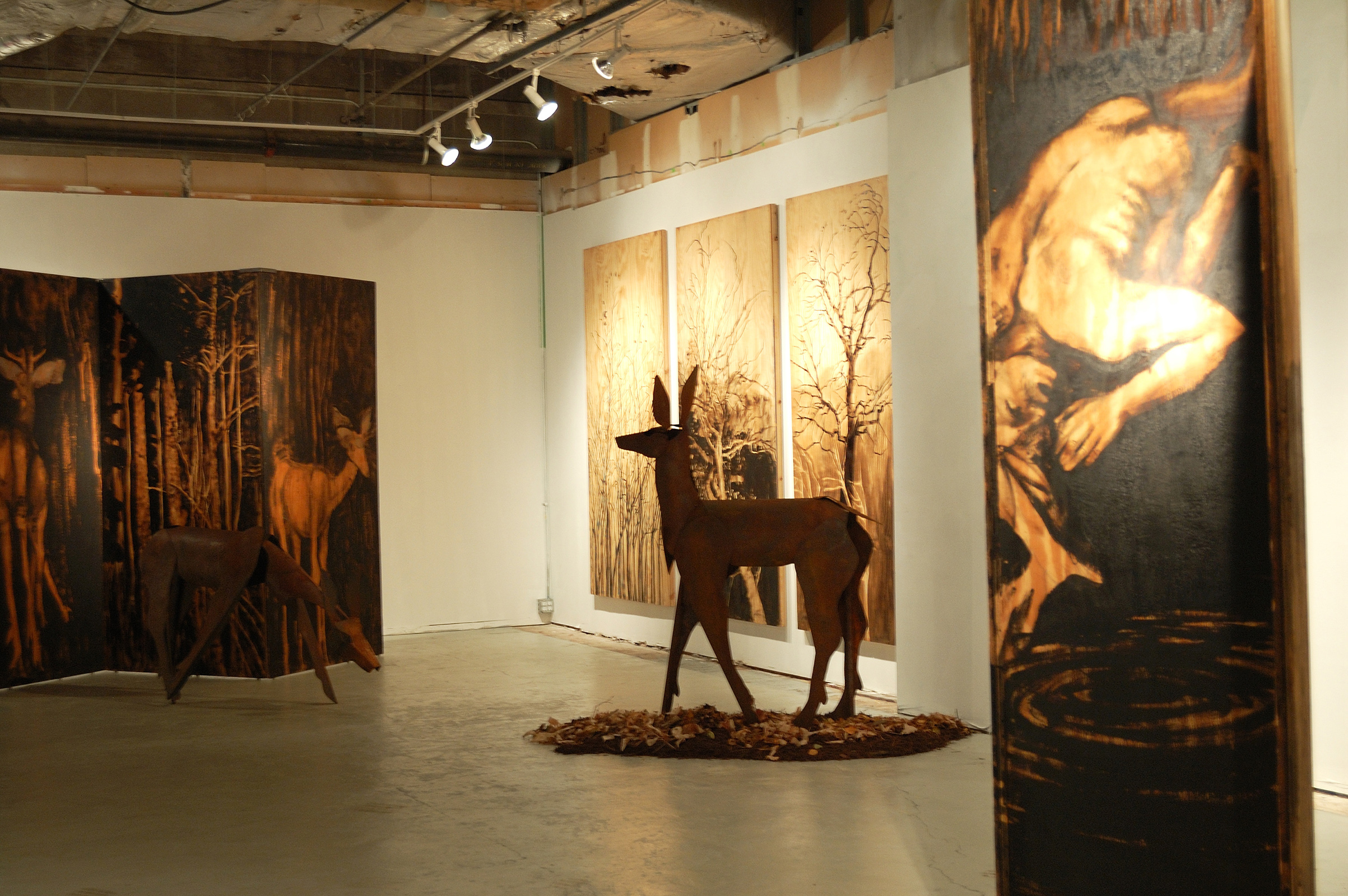 """Living Room"" was a one-person show at Gallery 13, 811 LaSalle St., Minneapolis, MN.  The animals are life-size, Corten steel, the panels, both freestanding  and wall-hung, are each 4' x 8' plywood, painted in asphaltum."