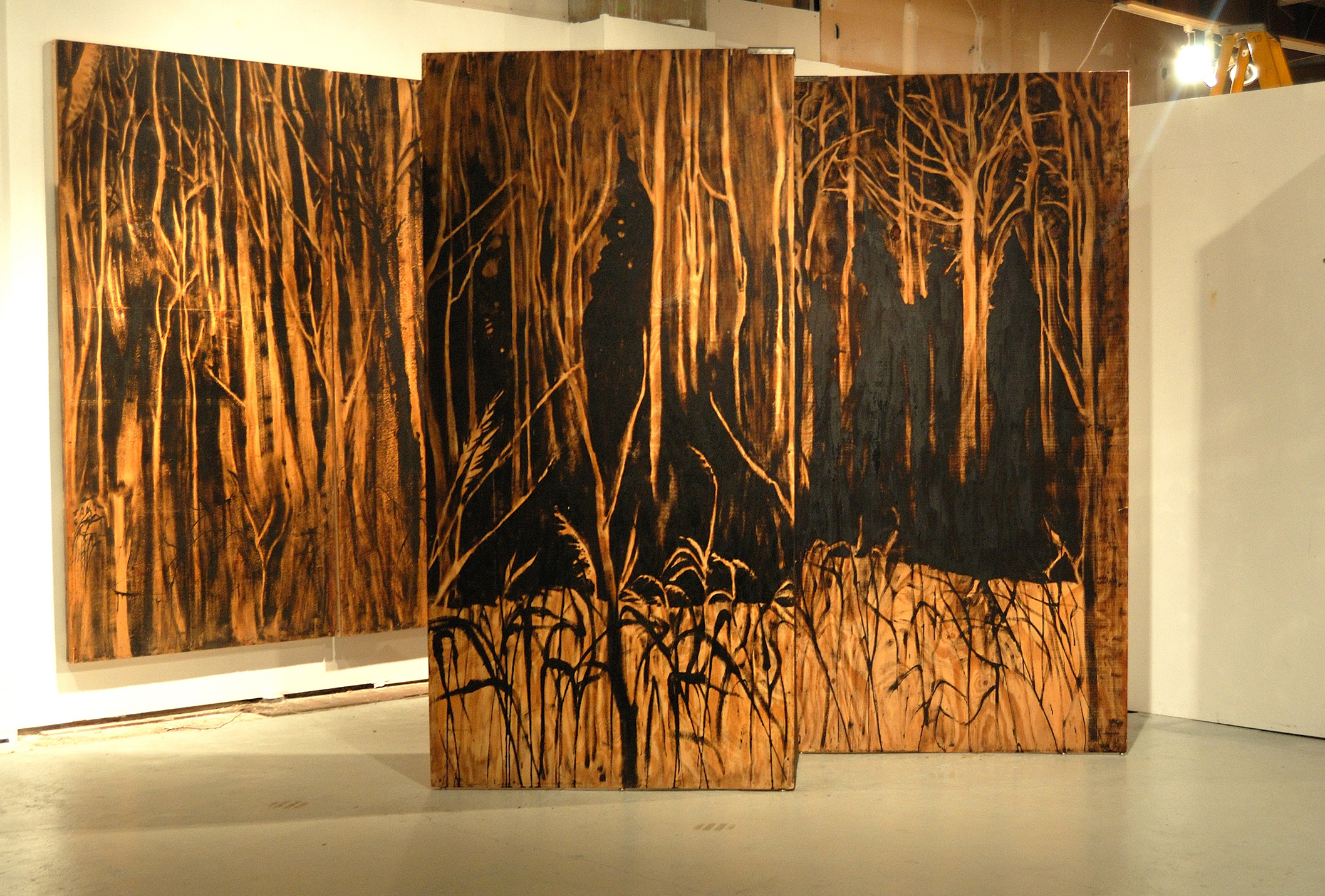 """Living Room"" was a one-person show at Gallery 13, 811 LaSalle St., Minneapolis, MN.  The panels, both freestanding  and wall-hung, are each 4' x 8' plywood, painted in asphaltum. They are part of an ongoing series called ""Forest."""
