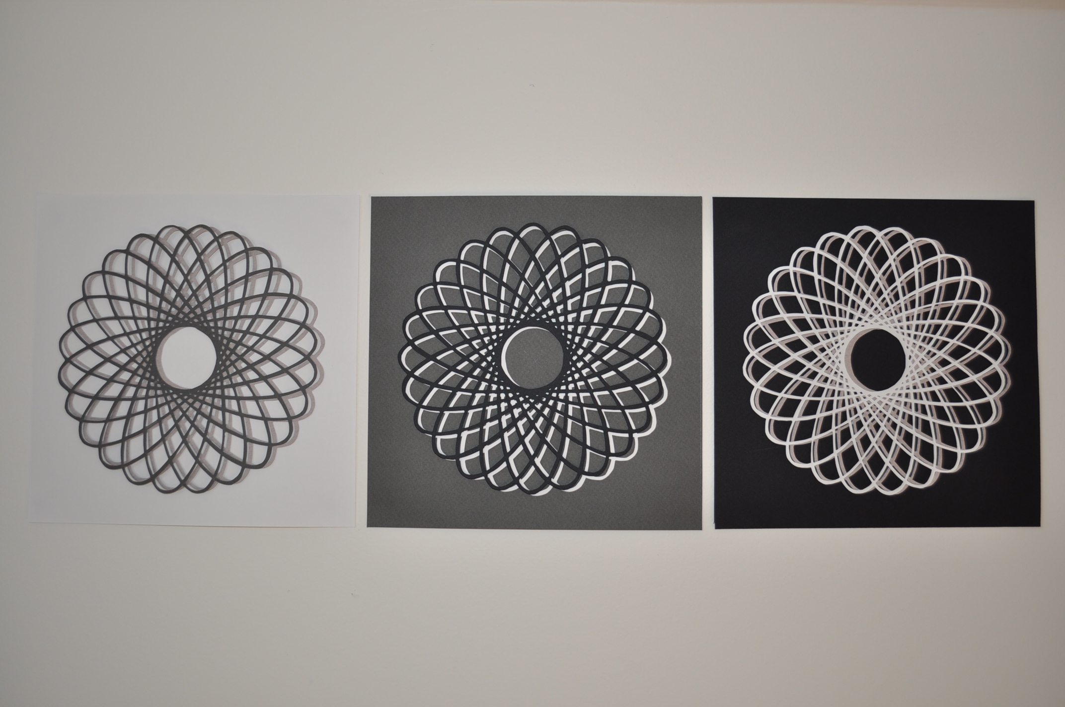 """""""Hypotrochoid Triptych  """"   Measures 7 1/2 x 22 1/2 inches. Light and dark grey on white background; black and white on dark grey background; white and light grey on black background.  Available for purchase on  Etsy ."""