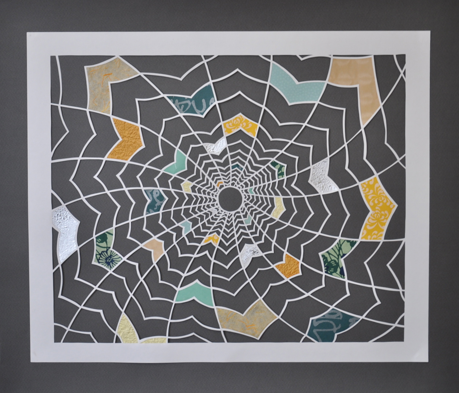 """""""Geomancy""""   Measures 17 x 19 1/2 inches. White paper cut with inserts of multi-coloured textured Japanese art papers against a dark grey background.  Available for purchase on  Etsy ."""