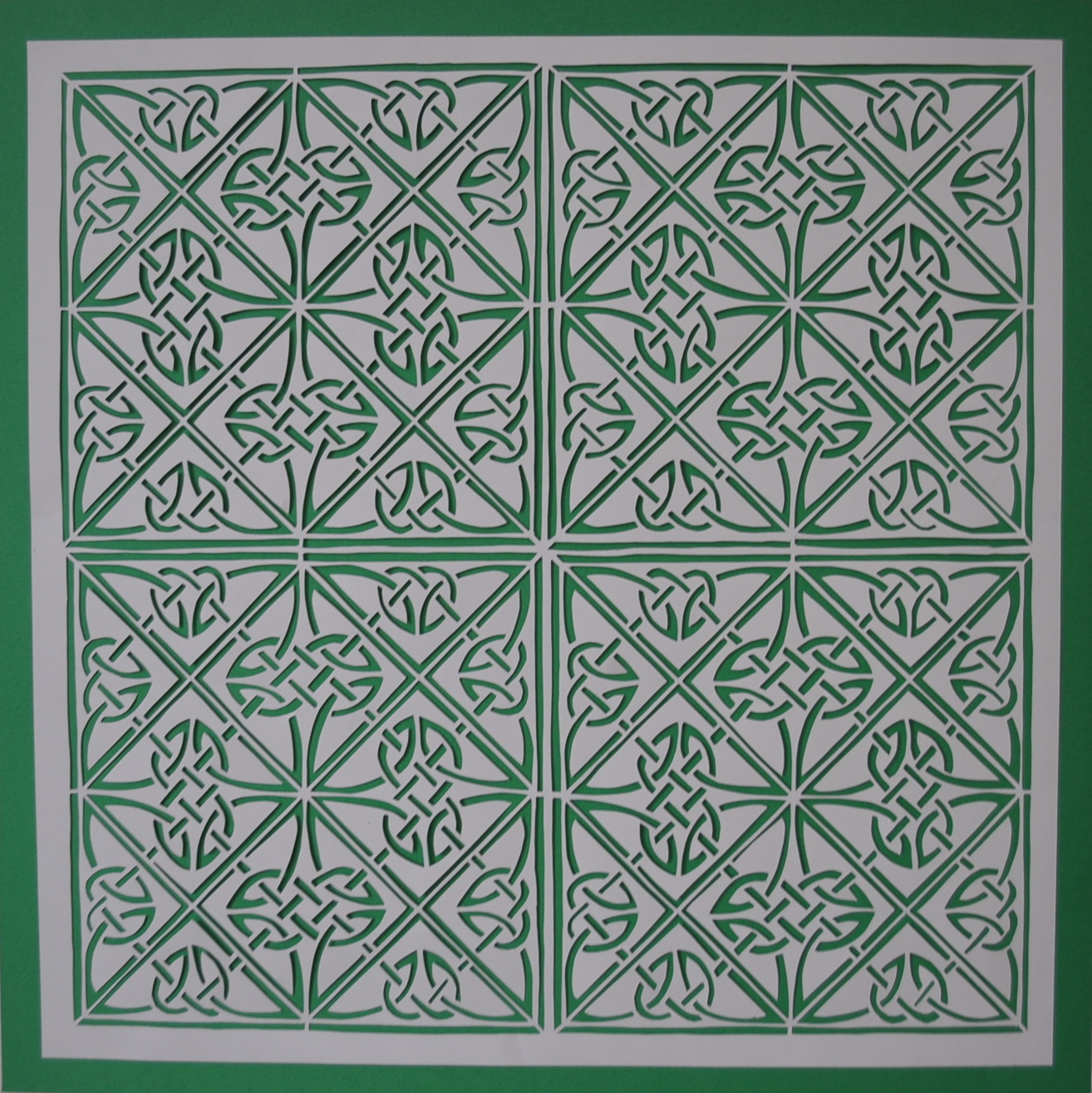 """""""Knotted""""   Measures 15 x 15 inches. White on emerald green background.  SOLD."""