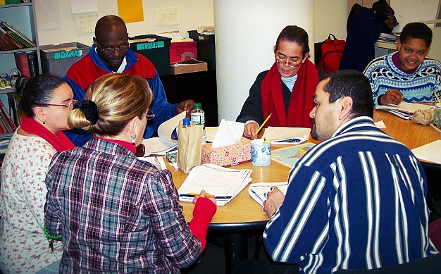 Next Step clients work on prepping resumes in a workshop.