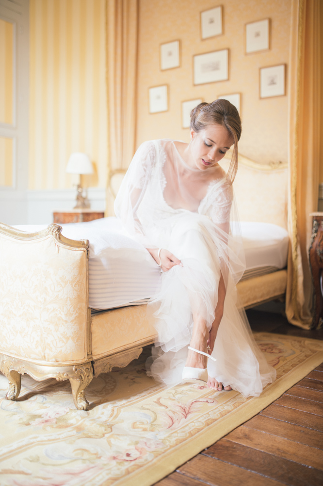 bride-putting-on-shoes.jpg