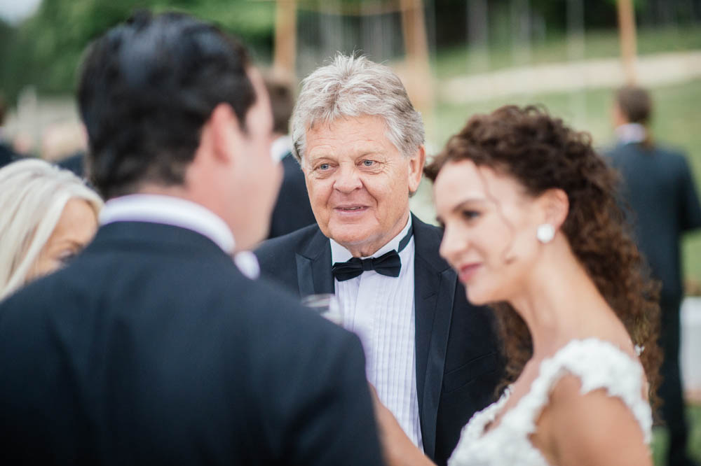 wedding-guests-talking-newlyweds.jpg