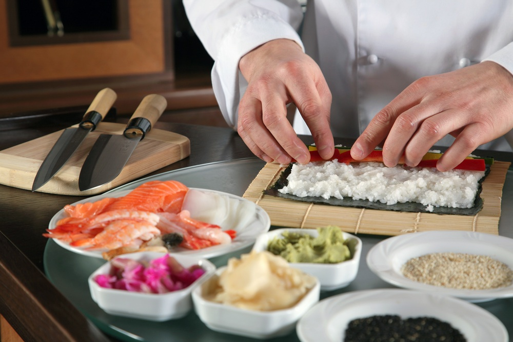 Chef teaching sushi rolling.jpg