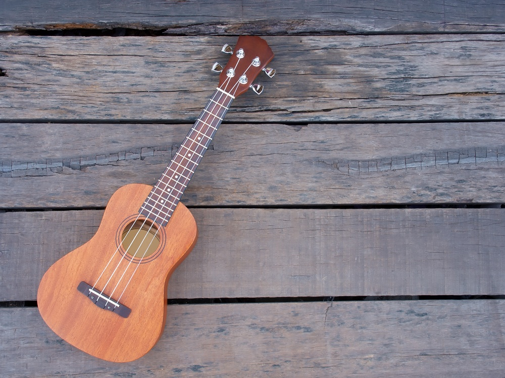 Ukulele on wood deck.jpg