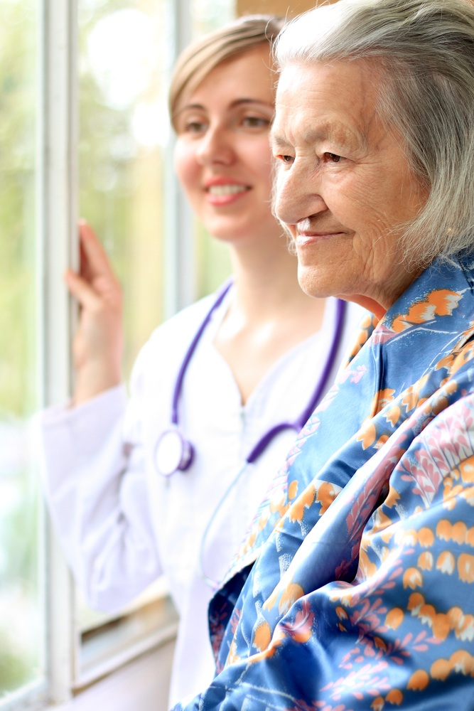 Woman & Nurse looking outside window.jpg