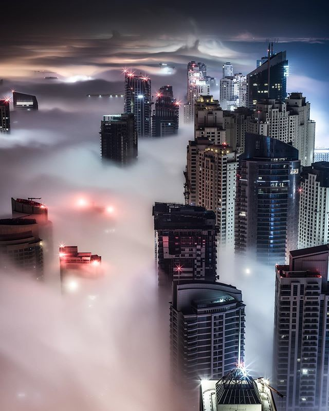 My first time shooting the fog in Dubai from a rooftop back in 2013. A phenomenon you simply have to witness to really take in the beauty. Helps being 76 floors up of course, otherwise you're just walking thru cotton. #dubai #cityscape #rooftop #sonya7r #uae #fog #foggy #naturallight #travel #sonymea #mydubai #night #dubainight