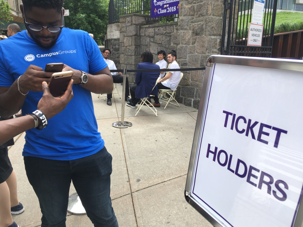 CCNY student volunteers and campusgroups team members check in guests celebrating the class of 2018's commencement.