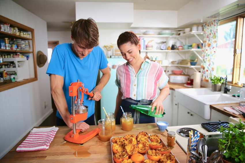 ick stops by to help Molly in the kitchen. Molly puts him to work helping squeeze the oranges for Nick's Favorite Grilled Orange Soda.jpeg
