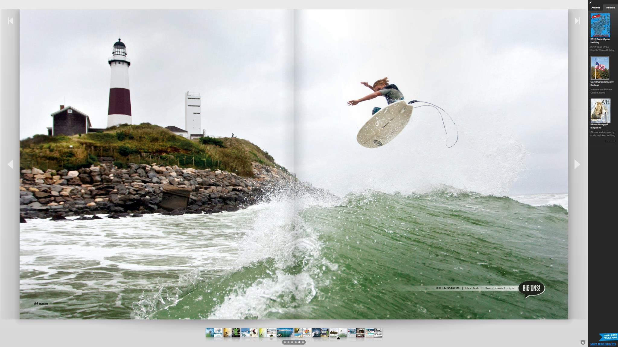 Leif Engstrom Boosting one in front of the lighthouse.  Double Page Spread in Eastern Surf Magazine