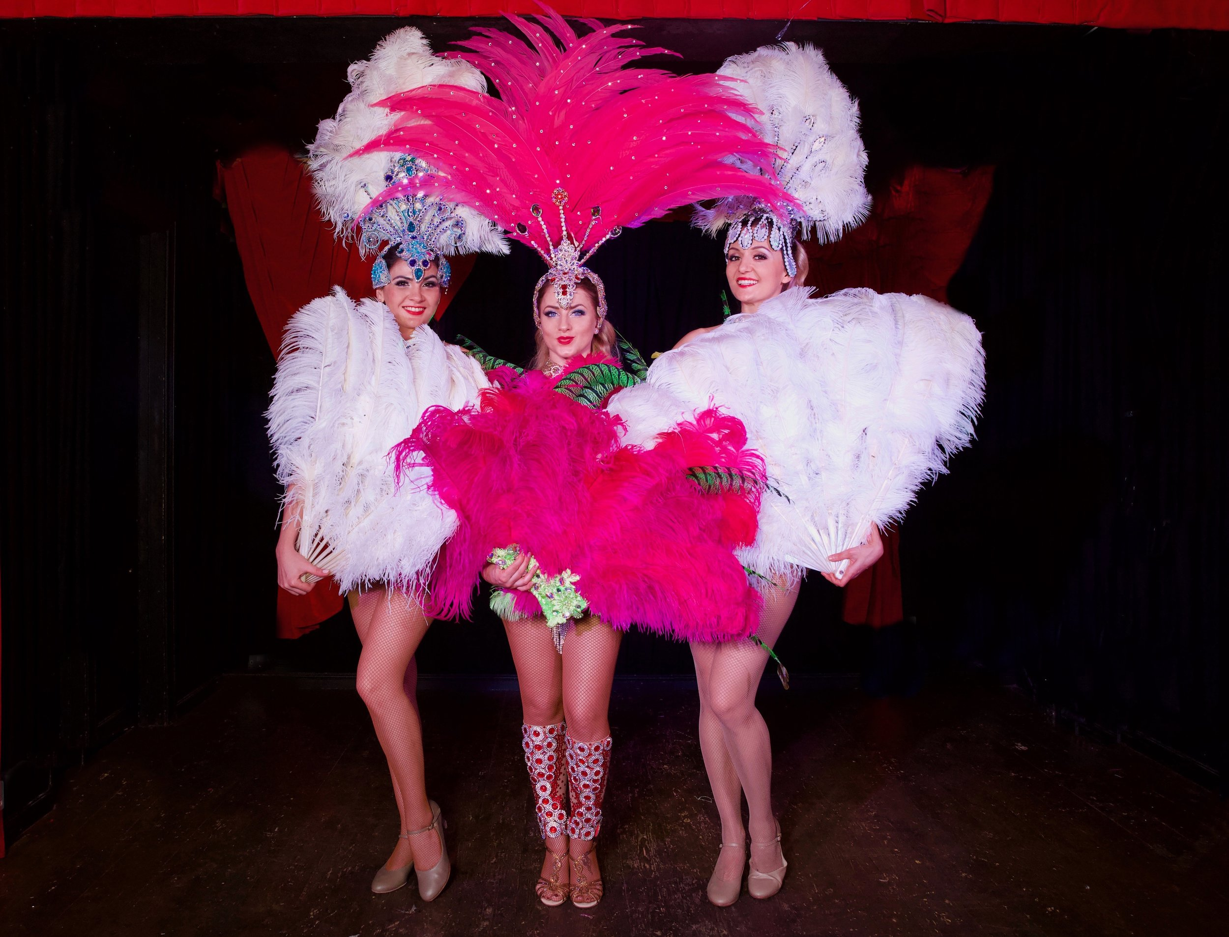 3 showgirls with feathers.jpeg