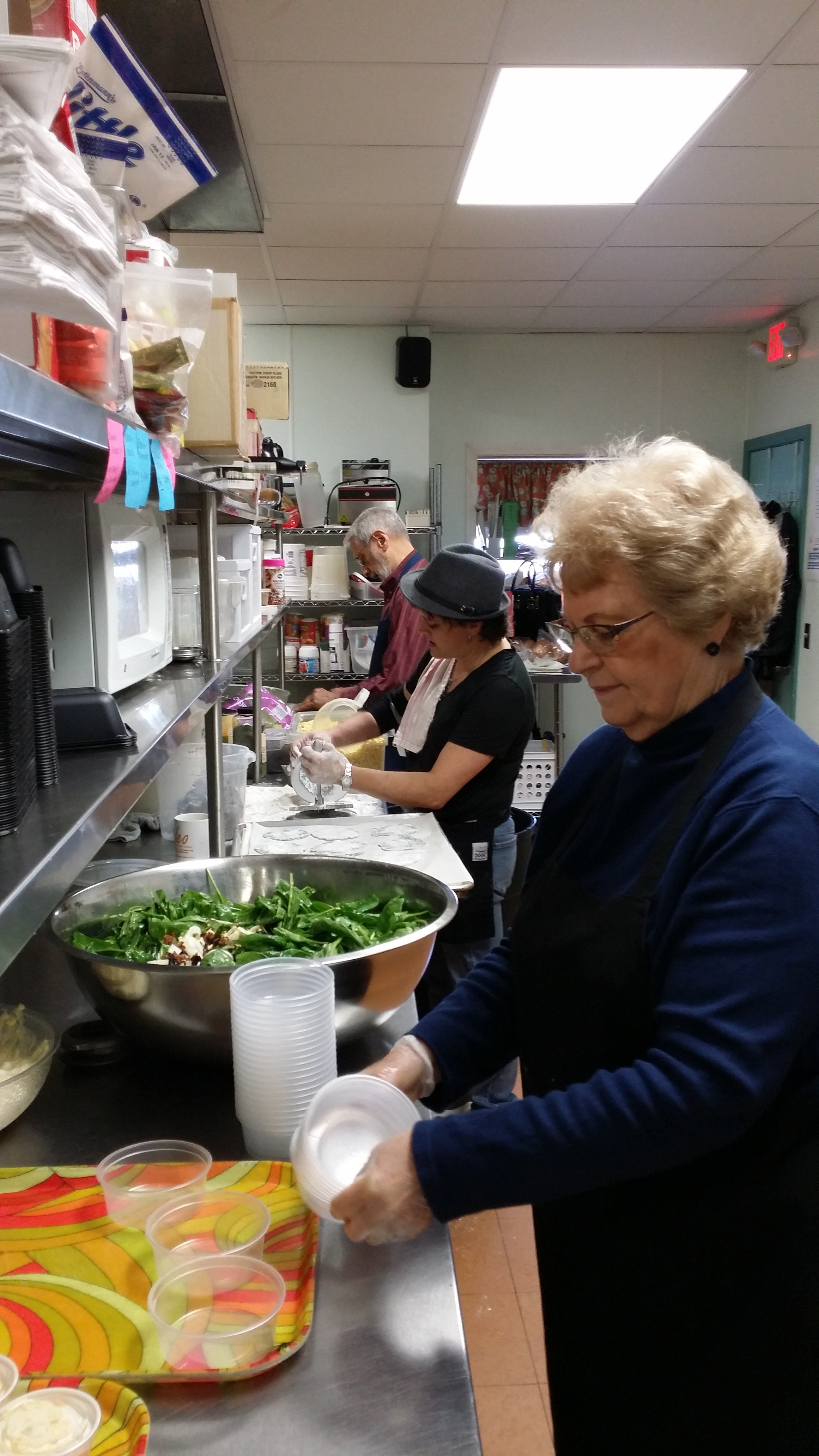 Kitchen staff preparing lunches for our Meals on Wheels program.