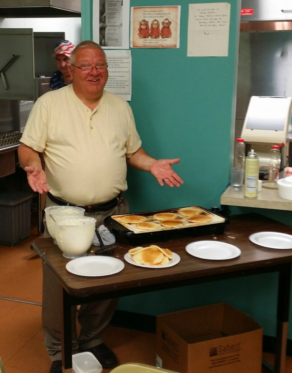 Greg serving pancakes during the breakfast hour.