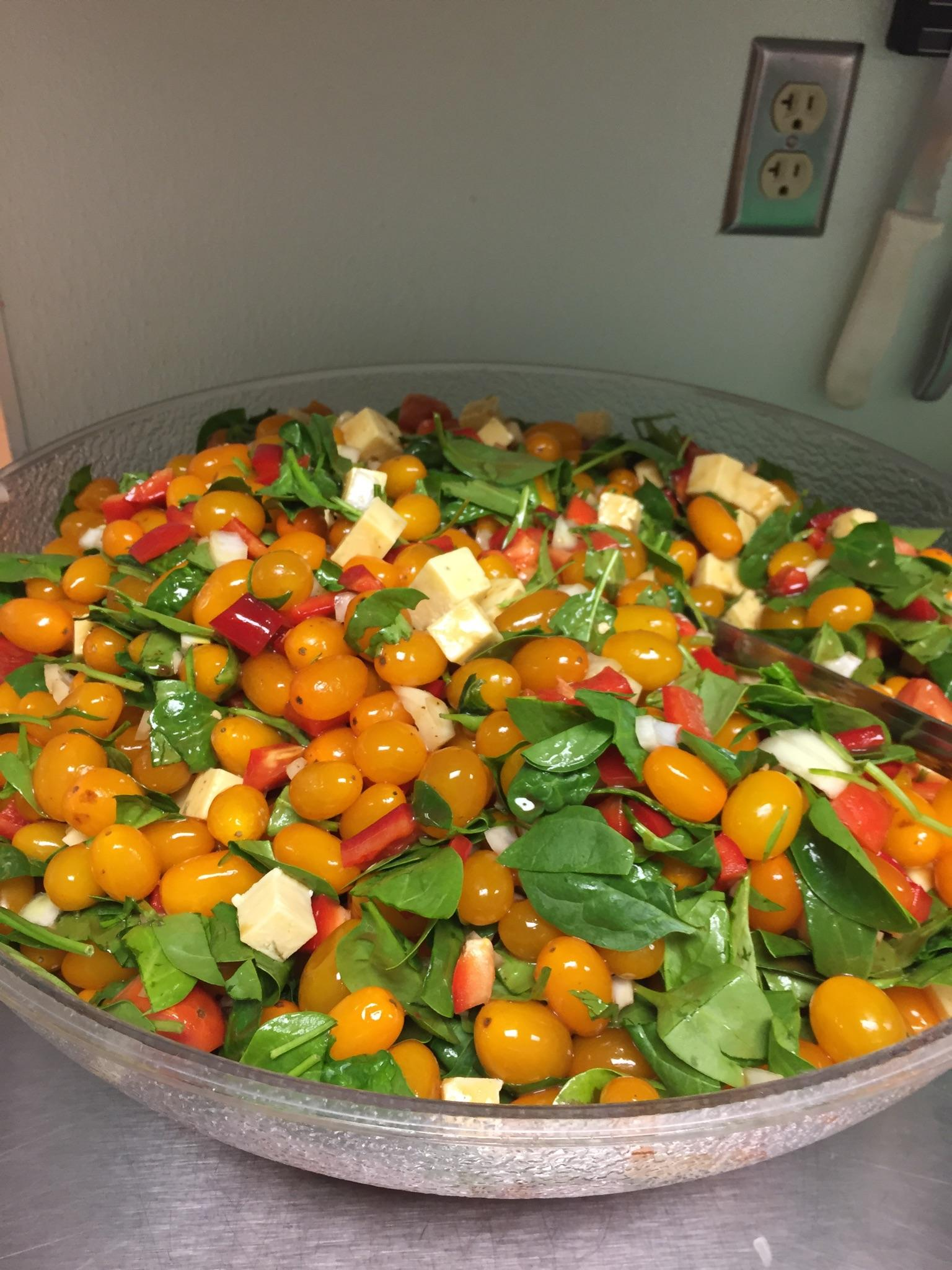 Colorful salads are a typical part of the nutritious meals we serve.