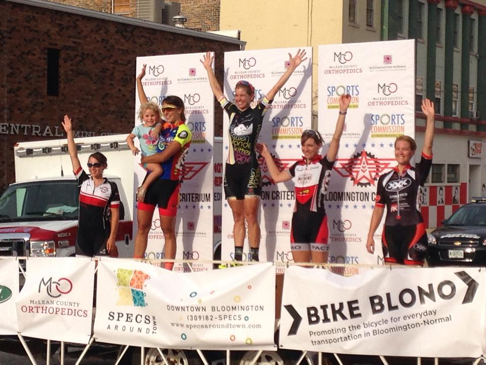 Daphne and niece Cora take applause from the crowd at the Bloomington Criterium
