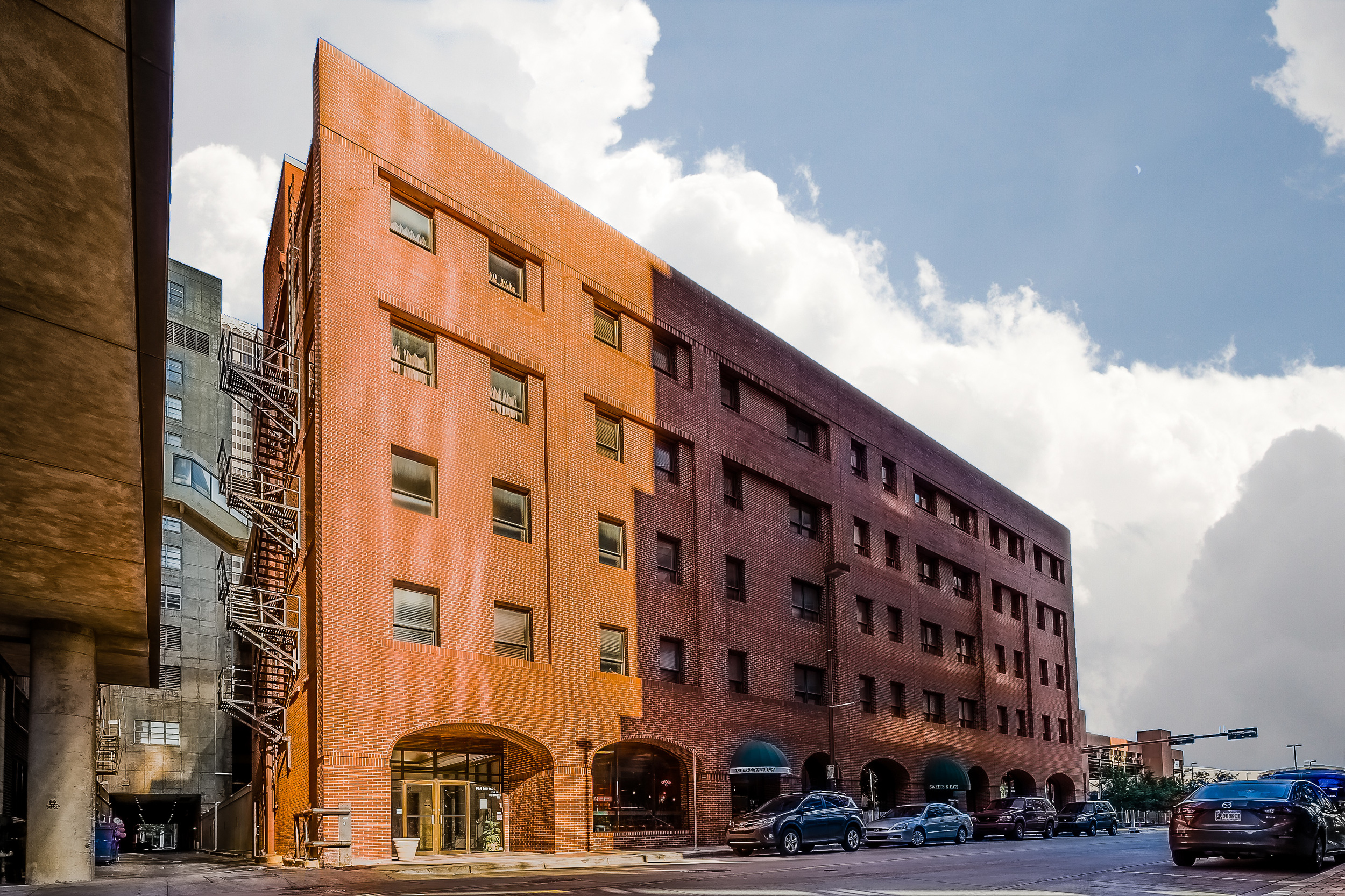 An as yet unnamed building at Main and Robinson. Not sure if it has a name. But I love the red brick.