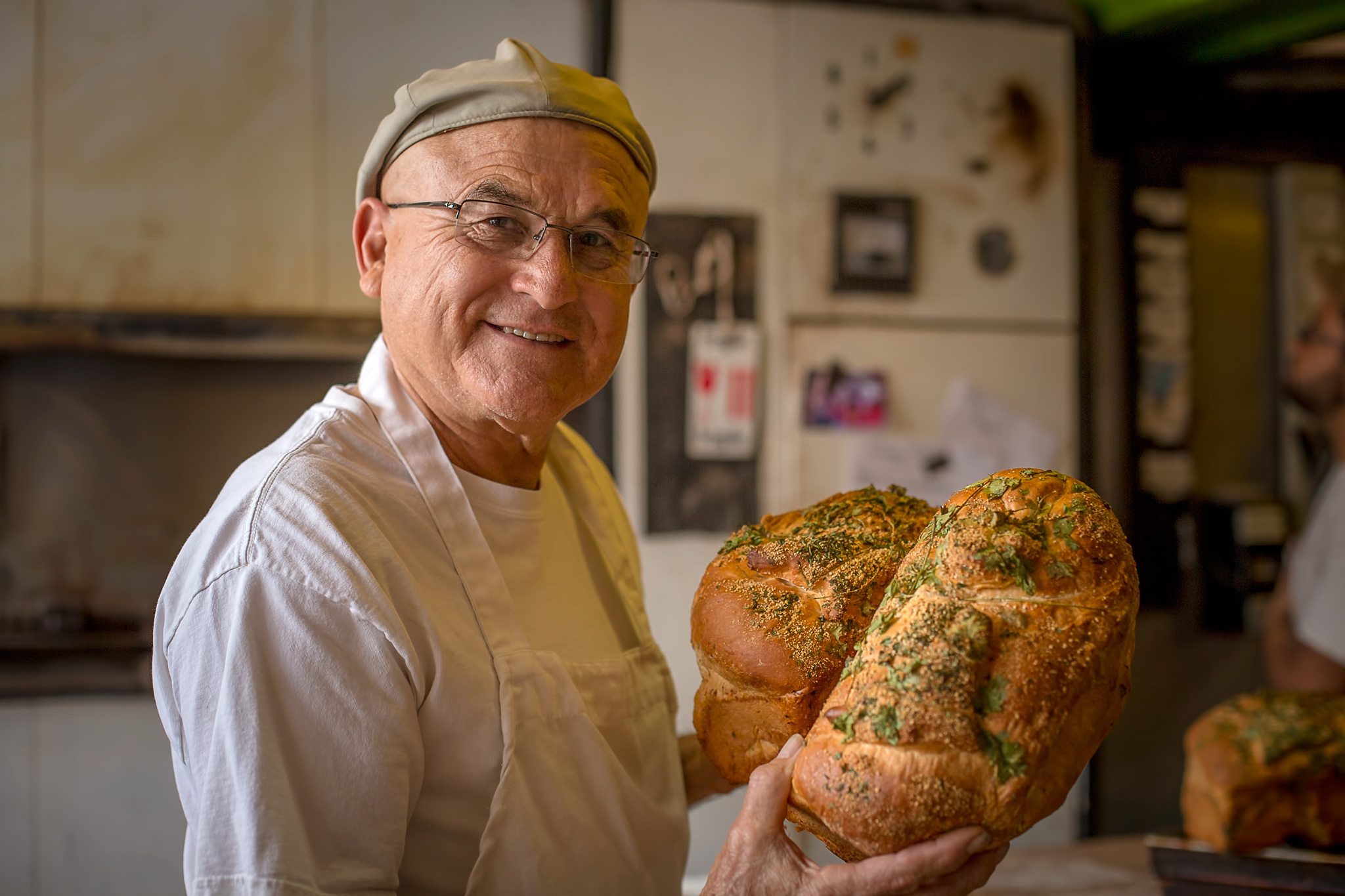 Pratt Morales of the Golden Crown Panaderia makes these beautiful cilantro loaves every day. Delicious!