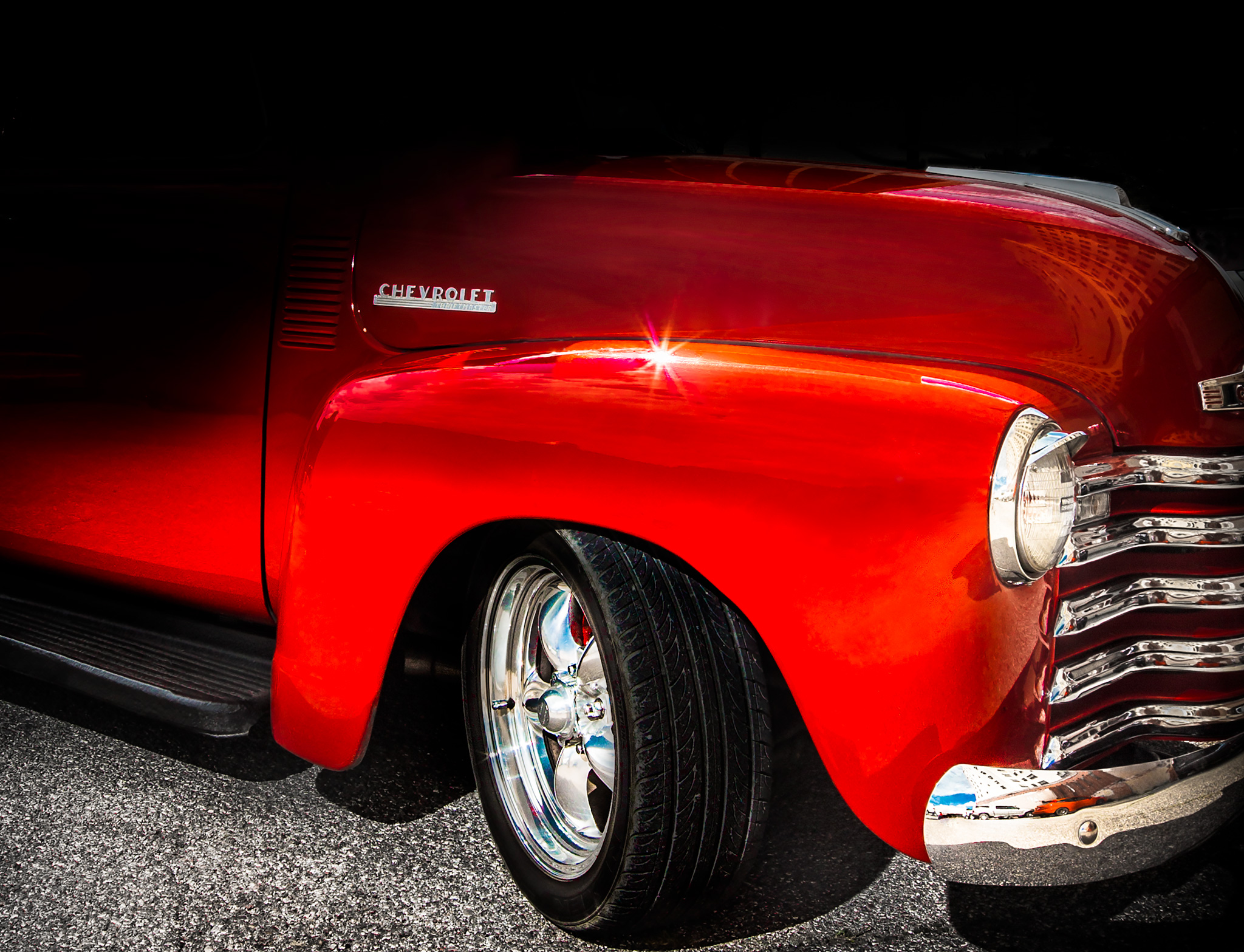A very red 52 Chevy truck. Who knew that a 60+ year old pickup truck fender could be so enticing you'd want to lick it?
