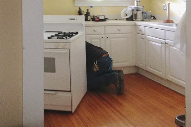 Plumber fixing gas