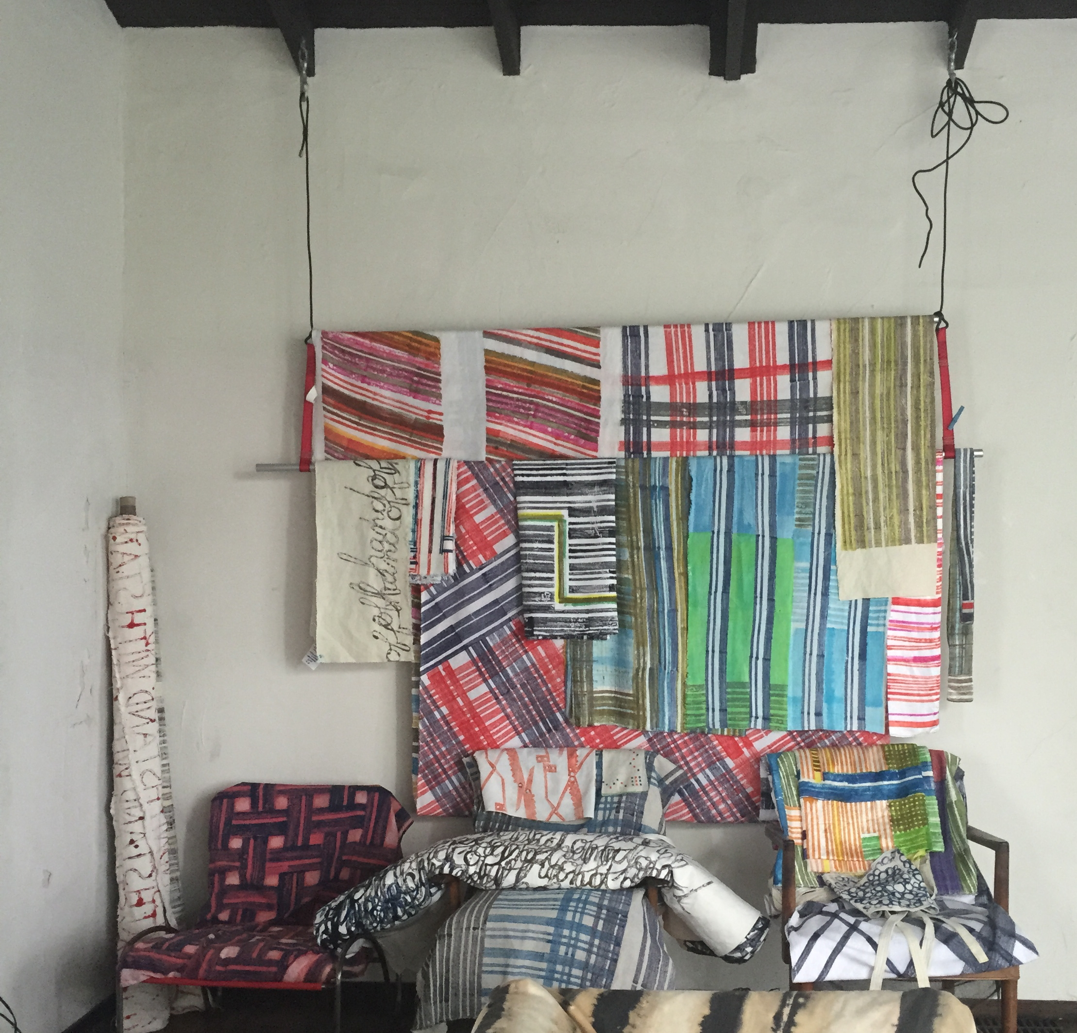 Untitled installation. Infinite Stripes series.  Block print, dye on cloth (all linen except one cotton piece, various weights). 2015