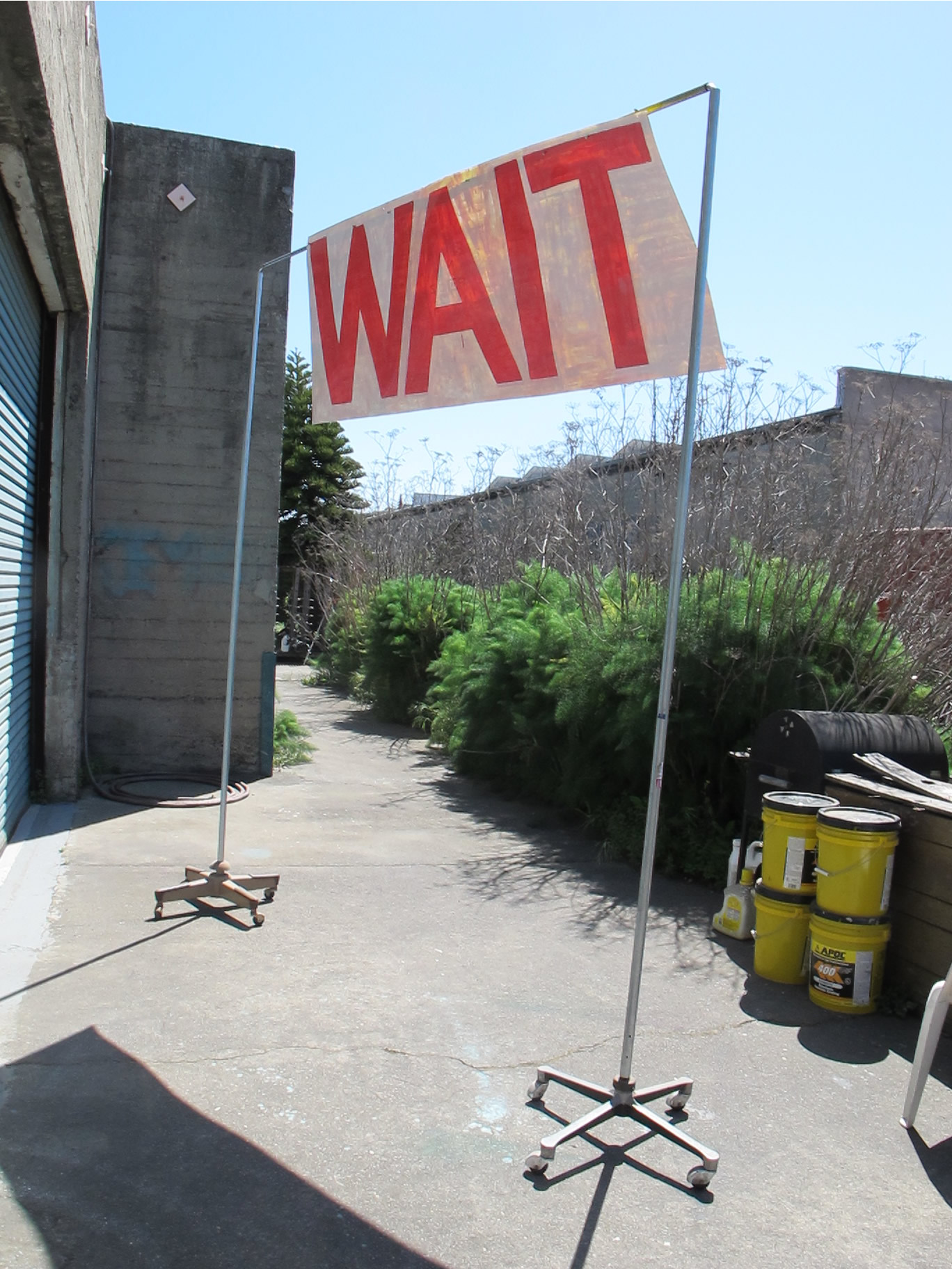 WAIT. 2010  Sign paint on laminated digital print. Double sided. NeoDymium magnets. Amputated vintage office chair bases and steel tubing.