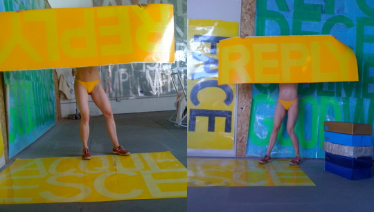 Acquiesce. Reply. Custom knickers. 2009-10  Sign paint on laminated digital prints. Artist in knickers and sneakers. Product boxes (containing client projects and assorted items, like zippers and waistbands) made from old 500# paper drawings, sign paint, staples.