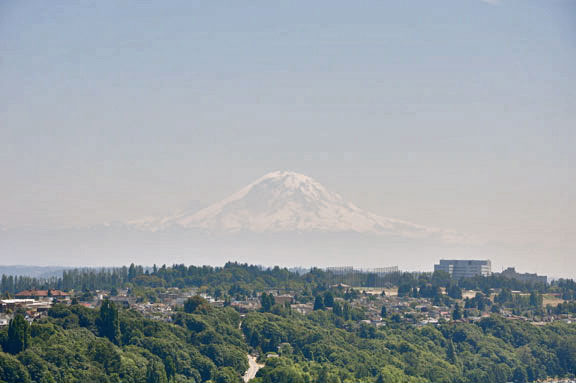 Difficult to see, but Mount Rainier appears ghostly in the distance