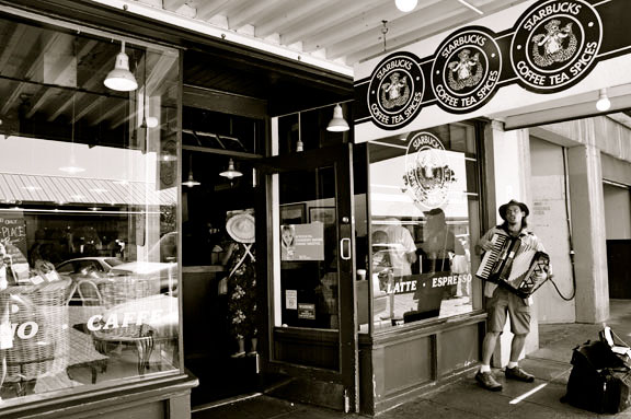 "The original Starbucks at Pike Place Market (with a man singing an interesting acoustic rendition of Prince's ""When Doves Cry"")"